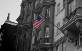 L-1B Visa Intracompany Transferee US Flag on Foreign Embassy