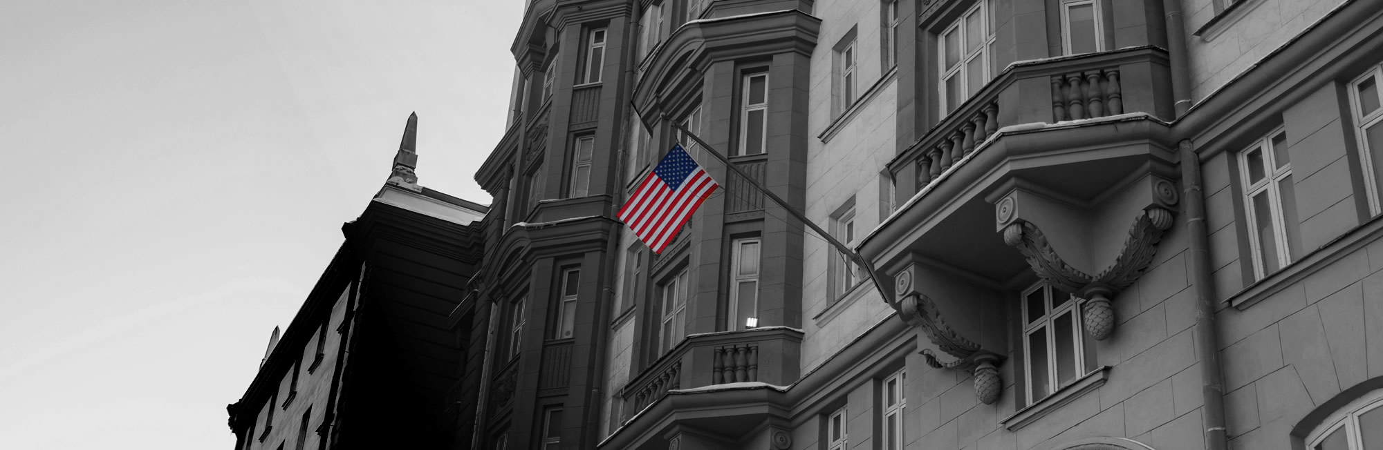 L-1B Visa Intracompany Transferee US Flag on Foreign Embassy