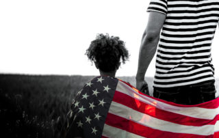 Young girl with father and US flag